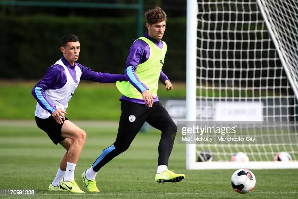 John Stones and Phil Foden of Manchester City in action during the training session at Manchester City Football Academy on August 29 2019 in...