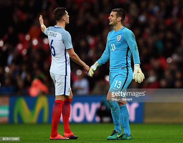 John Stones and Tom Heaton of England react as Iago Aspas of Spain scores their first goal during the international friendly match between England...