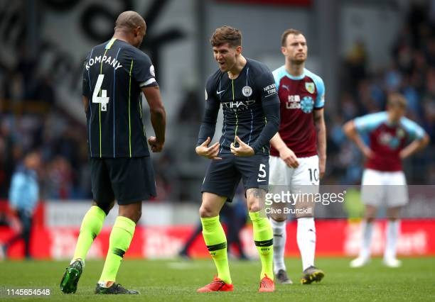 John Stones and Vincent Kompany of Manchester City celebrate victory after the Premier League match between Burnley FC and Manchester City at Turf...