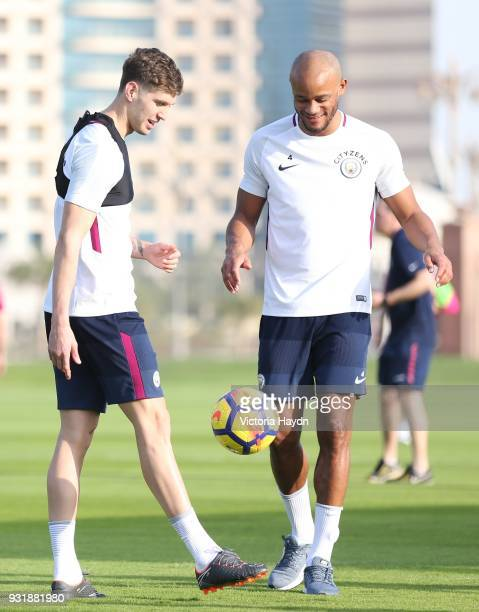 John Stones and Vincent Kompany of Manchester City during the Abu Dhabi Warm Weather Training Camp on March 13 2018 in Abu Dhabi United Arab Emirates