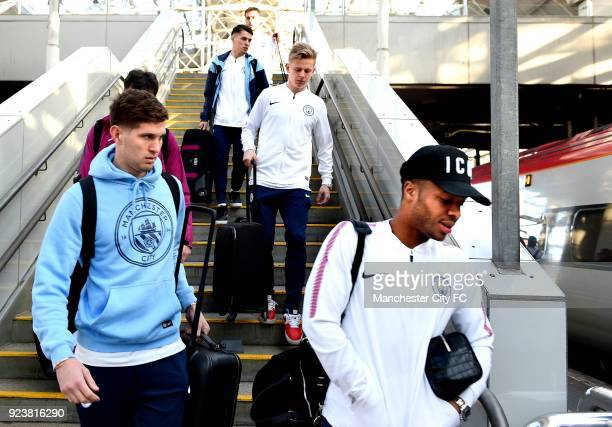 John Stones Brahim Diaz Oleksandr Zinchenko and Raheem Sterling of Manchester City arrives at Piccadilly train station on route to the Carabao Cup...