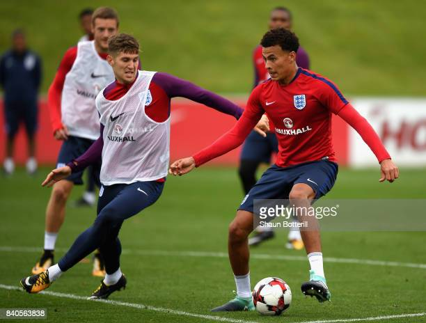 John Stones chases down Dele Ali of England during a England training session ahead of their World Cup Qualifiers against Malta and Slovakia at St...