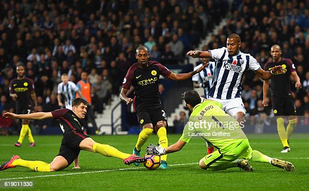 John Stones Fernandinho Claudio Bravo of Manchester City and Jose Salomon Rondon of West Bromwich Albion battle for the ball during the Premier...