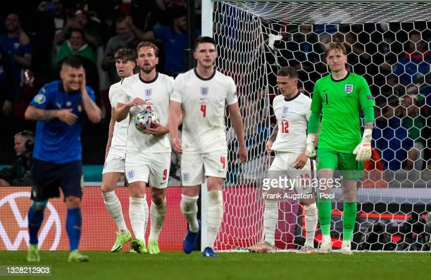 John Stones, Harry Kane, Declan Rice, Kieran Trippier and Jordan Pickford of England look dejected after conceding their side's first goal scored by...