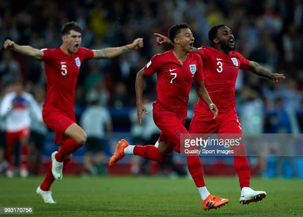 John Stones Jesse Lingard and Danny Rose celebrate after Eric Dier of England scores the winning penalty during the 2018 FIFA World Cup Russia Round...