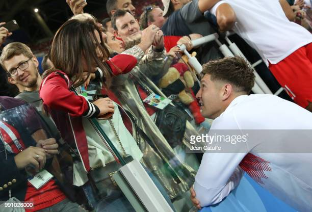 John Stones of England and his girlfriend Millie Savage following the 2018 FIFA World Cup Russia Round of 16 match between Colombia and England at...