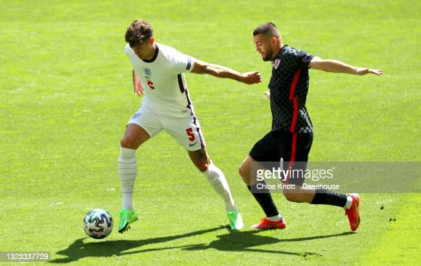 John Stones of England and Mateo Kovacic of Croatia in action during the UEFA Euro 2020 Championship Group D match between England and Croatia on...