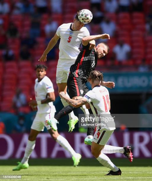 John Stones of England battles for a header with Ante Rebic of Croatia during the UEFA Euro 2020 Championship Group D match between England and...