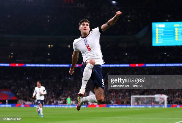 John Stones of England celebrates after scoring their team's first goal during the 2022 FIFA World Cup Qualifier match between England and Hungary at...
