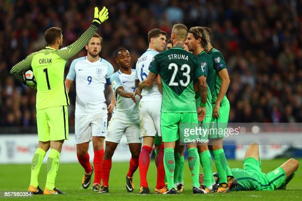 John Stones of England clashes with Aljaz Struna of Slovenia during the FIFA 2018 World Cup Group F Qualifier between England and Slovenia at Wembley...