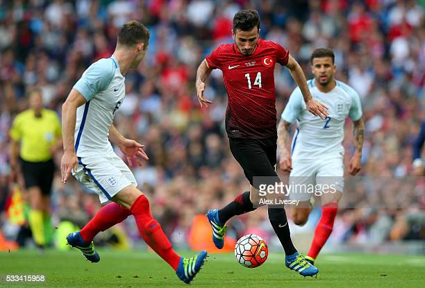 John Stones of England closes down Oguzhan Ozyakup of Turkey during the International Friendly match between England and Turkey at Etihad Stadium on...