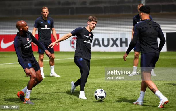 John Stones of England controls the ball during the England training session at St Georges Park on June 6 2018 in BurtonuponTrent England