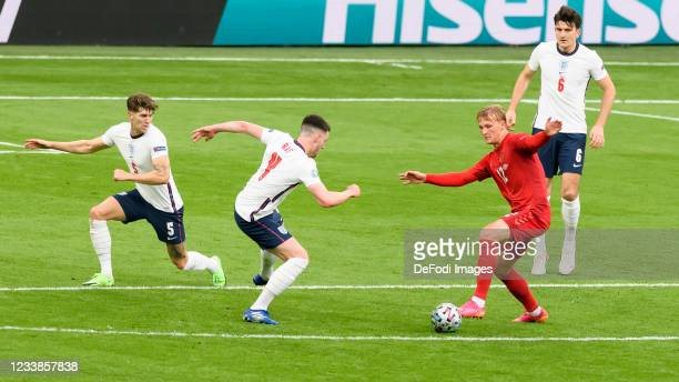 John Stones of England, Declan Rice of England and Kasper Dolberg of Denmark battle for the ball during the UEFA Euro 2020 Championship Semi-final...