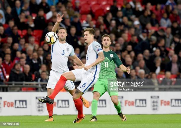 John Stones of England in action against Andraz Sporar of Slovenia during the 2018 FIFA World Cup European Qualification football match between...