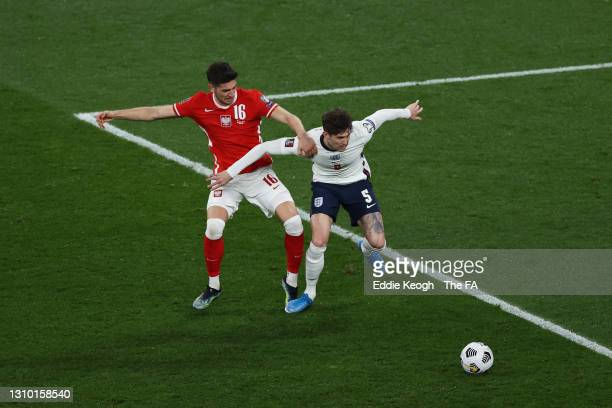 John Stones of England is challenged by Jakub Moder of Poland and goes on to score his side's first goal during the FIFA World Cup 2022 Qatar...