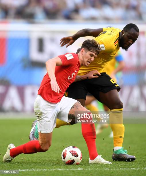 John Stones of England is challenged by Romelu Lukaku of Belgium during the 2018 FIFA World Cup Russia 3rd Place Playoff match between Belgium and...