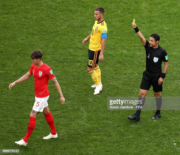 John Stones of England is shown a yellow card by referee Referee Alireza Faghani during the 2018 FIFA World Cup Russia 3rd Place Playoff match...