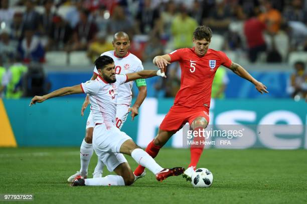 John Stones of England is tackled by Ferjani Sassi during the 2018 FIFA World Cup Russia group G match between Tunisia and England at Volgograd Arena...