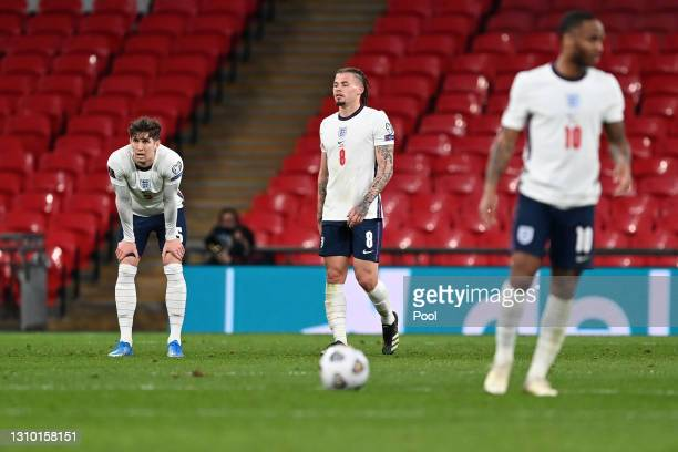 John Stones of England looks dejected after conceding their side's first goal scored by Jakub Moder of Poland during the FIFA World Cup 2022 Qatar...