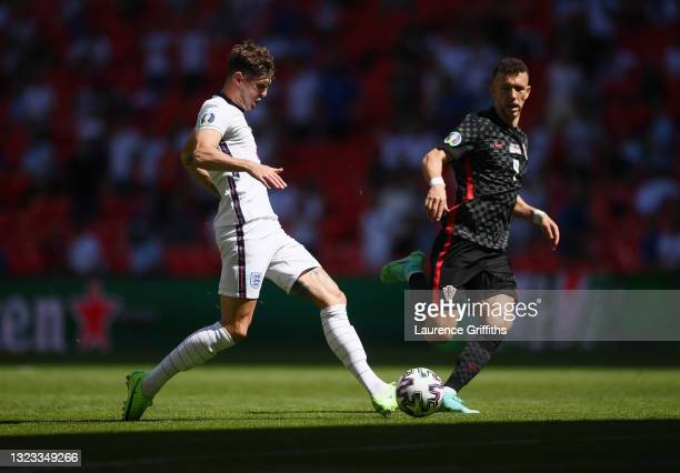 John Stones of England passes the ball whilst under pressure from Ivan Perisic of Croatia during the UEFA Euro 2020 Championship Group D match...