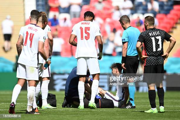 John Stones of England receives medical treatment during the UEFA Euro 2020 Championship Group D match between England and Croatia at Wembley Stadium...