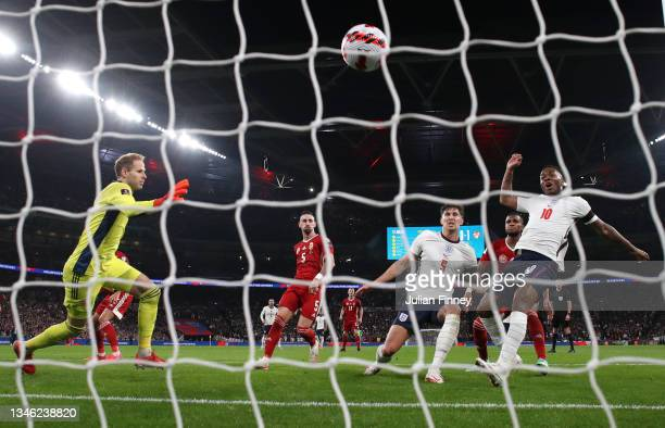 John Stones of England scores their team's first goal past Peter Gulacsi of Hungary during the 2022 FIFA World Cup Qualifier match between England...