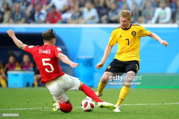 John Stones of England tackles Kevin De Bruyne of Belgium during the 2018 FIFA World Cup Russia 3rd Place Playoff match between Belgium and England...