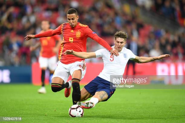 John Stones of England tackles Rodrigo Moreno of Spain leading to a yellow card being shown to John Stones during the UEFA Nations League A group...