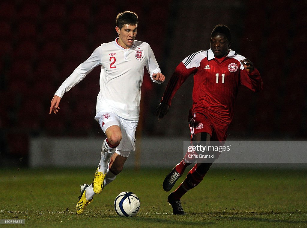 John Stones of England U19 in action with Danny Amankwaa of Denmark U19 during the International Match between England U19 and Denmark U19 at Keepmoat Stadium on February 5, 2013 in Doncaster, England.