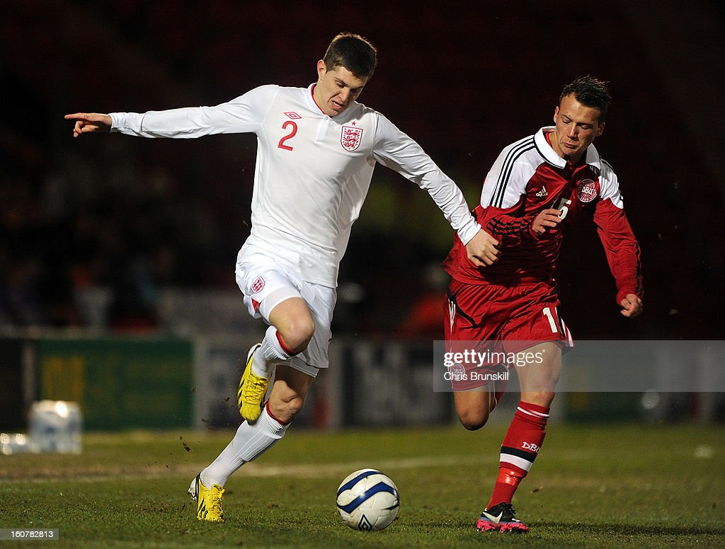 John Stones of England U19 in action with Kristian Lindberg of Denmark U19 during the International Match between England U19 and Denmark U19 at Keepmoat Stadium on February 5, 2013 in Doncaster, England.