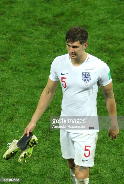 John Stones of England walks off the pitch dejected following his team's defeat in the 2018 FIFA World Cup Russia Semi Final match between England...
