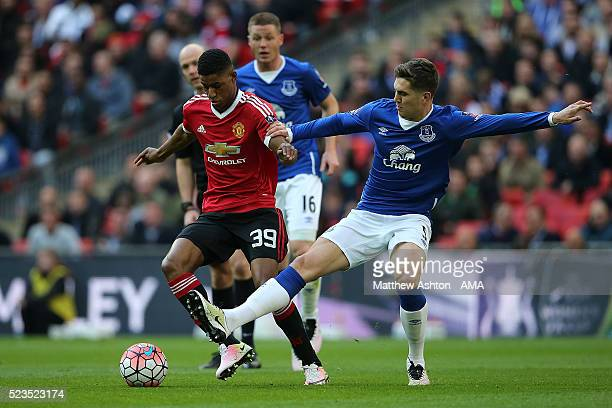 John Stones of Everton challenges Marcus Rashford of Manchester United during the Emirates FA Cup Semi Final match between Everton and Manchester...