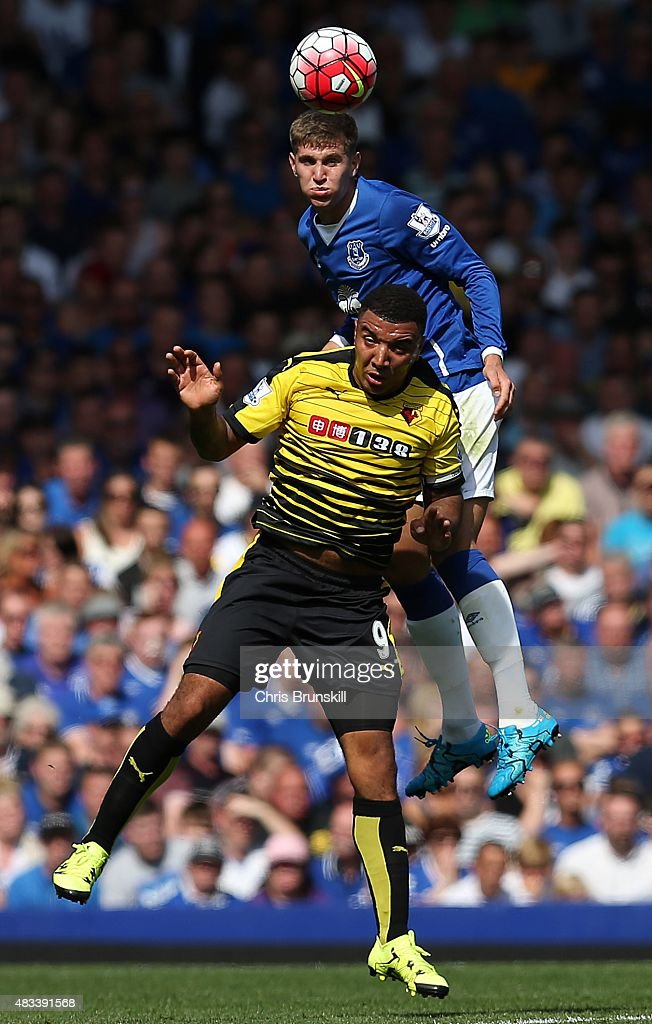 John Stones of Everton in action with Troy Deeney of Watford during the Barclays Premier League match between Everton and Watford at Goodison Park on August 8, 2015 in Liverpool, England.
