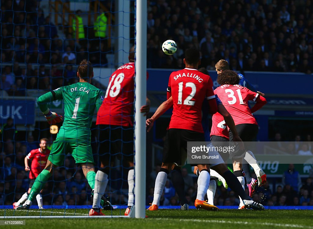 John Stones of Everton (obscured right) scores their second goal with a header during the Barclays Premier League match between Everton and Manchester United at Goodison Park on April 26, 2015 in Liverpool, England.
