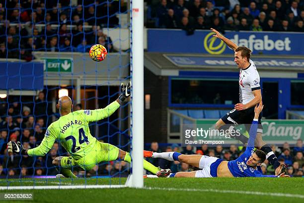 John Stones of Everton slides in to block a shot from Harry Kane of Tottenham Hotspur during the Barclays Premier League match between Everton and...