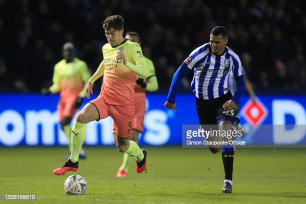 John Stones of Man City battles with Alessio da Cruz of Sheff Wed during the FA Cup Fifth Round match between Sheffield Wednesday and Manchester City...