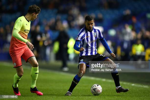 John Stones of Manchester City and Alessio Da Cruz of Sheffield Wednesday during the FA Cup Fifth Round match between Sheffield Wednesday and...