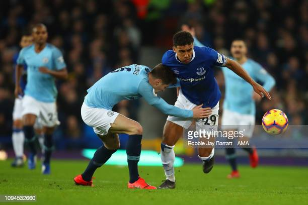 John Stones of Manchester City and Dominic CalvertLewin of Everton during the Premier League match between Everton FC and Manchester City at Goodison...