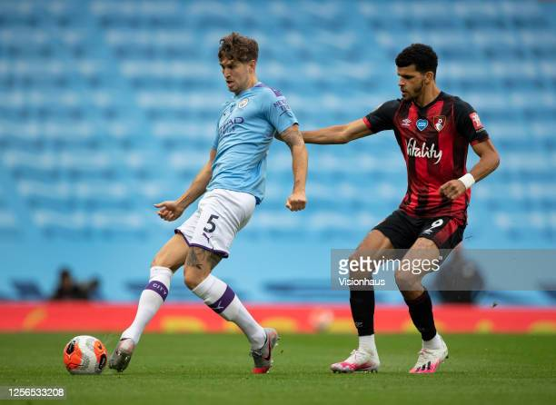 John Stones of Manchester City and Dominic Solanke of AFC Bournemouth in action during the Premier League match between Manchester City and AFC...