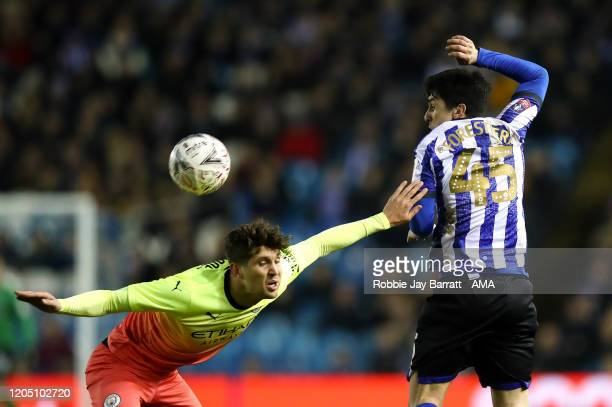 John Stones of Manchester City and Fernando Forestieri of Sheffield Wednesday during the FA Cup Fifth Round match between Sheffield Wednesday and...