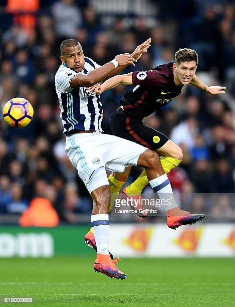 John Stones of Manchester City and Jose Salomon Rondon of West Bromwich Albion compete for the ball during the Premier League match between West...