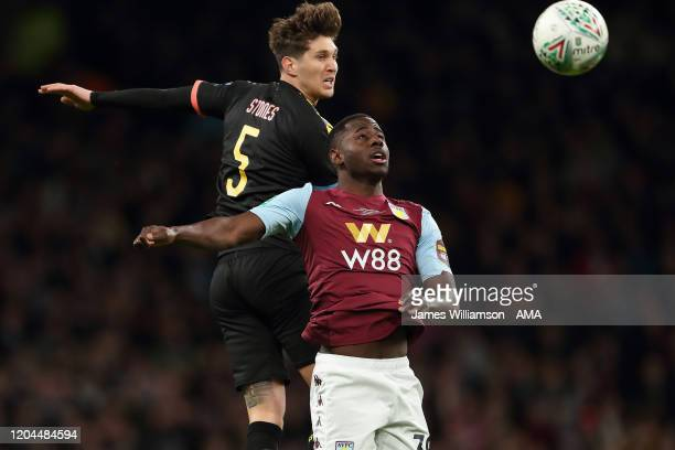 John Stones of Manchester City and Keinan Davis of Aston Villa during the Carabao Cup Final between Aston Villa and Manchester City at Wembley...