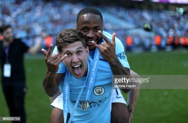 John Stones of Manchester City and Raheem Sterling of Manchester City celebate winning the premier league after the Premier League match between...