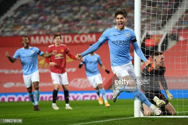 John Stones of Manchester City celebrates after scoring his team's first goal during the Carabao Cup Semi Final match between Manchester United and...