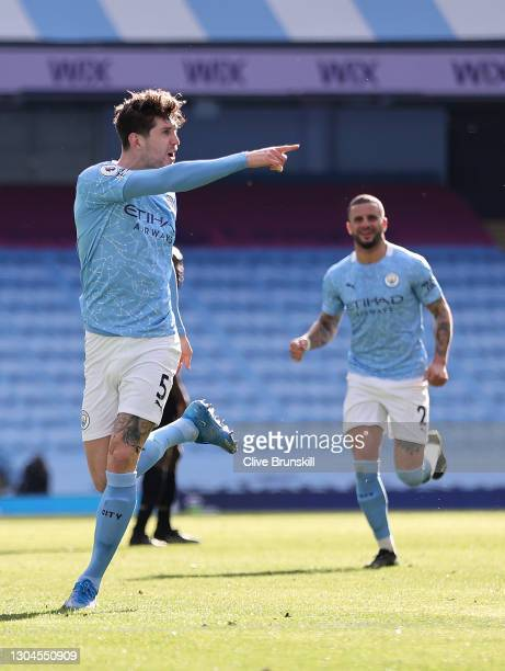 John Stones of Manchester City celebrates after scoring his team's second goal during the Premier League match between Manchester City and West Ham...