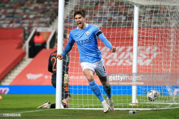 John Stones of Manchester City celebrates after scoring their 1st goal during the Carabao Cup Semi Final match between Manchester United and...
