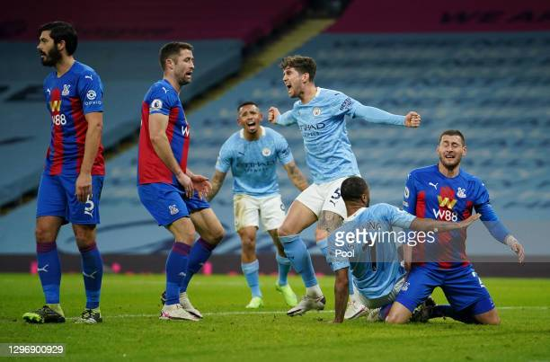 John Stones of Manchester City celebrates after scoring their side's first goal during the Premier League match between Manchester City and Crystal...