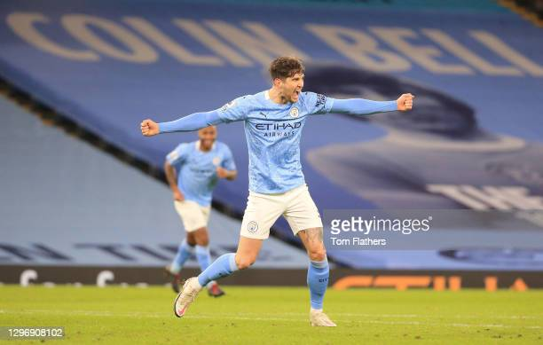 John Stones of Manchester City celebrates after scoring their sides third goal during the Premier League match between Manchester City and Crystal...