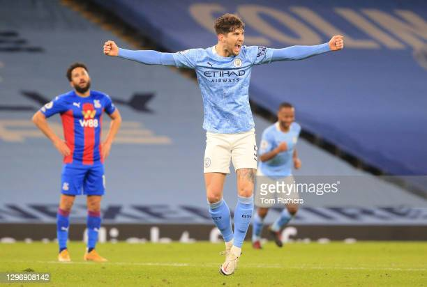 John Stones of Manchester City celebrates after scoring their side's third goal during the Premier League match between Manchester City and Crystal...