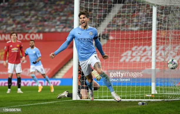 John Stones of Manchester City celebrates after scoring their team's first goal during the Carabao Cup Semi Final match between Manchester United and...